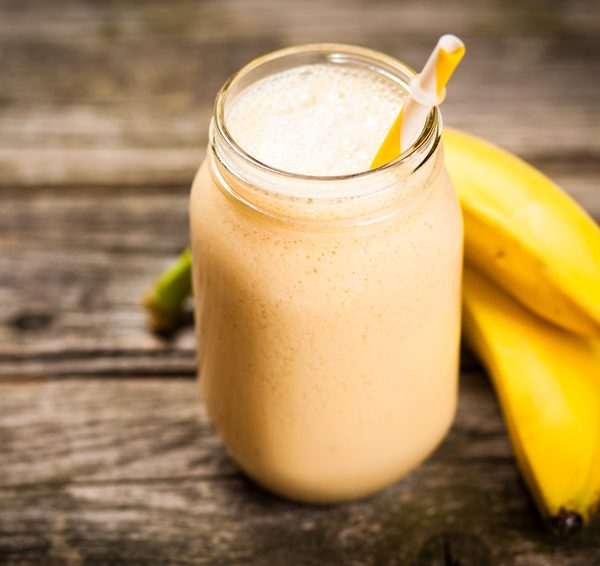 Banana milkshake on wooden table